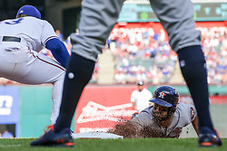 March 29, 2018 - Arlington, TX, U.S. - ARLINGTON, TX - MARCH 29: Texas Rangers third baseman Joey Gallo (13) tries tag Houston Astros second baseman Jose Altuve (27) sliding into first base during the game between the Texas Rangers and the Houston Astros on March 29, 2018 at Globe Life Park in Arlington, Texas. Houston defeats Texas 4-1. (Photo by Matthew Pearce/Icon Sportswire) (Credit Image: © Matthew Pearce/Icon SMI via ZUMA Press)