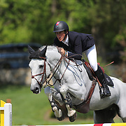 Ben Asselin riding Doremi in action during the $100,000 Empire State Grand Prix presented by the Kincade Group during the Old Salem Farm Spring Horse Show, North Salem, New York,  USA. 17th May 2015. Photo Tim Clayton