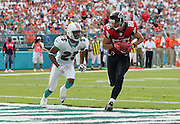 MIAMI - NOVEMBER 6:  Wide receiver Brian Finneran #86 of the Atlanta Falcons catches a touchdown pass while defended by cornerback Reggie Howard #25 of the Miami Dolphins on November 6, 2005 at Dolphins Stadium in Miami, Florida. The Falcons defeated the Dolphins 17-10. ©Paul Anthony Spinelli *** Local Caption *** Brian Finneran;Reggie Howard