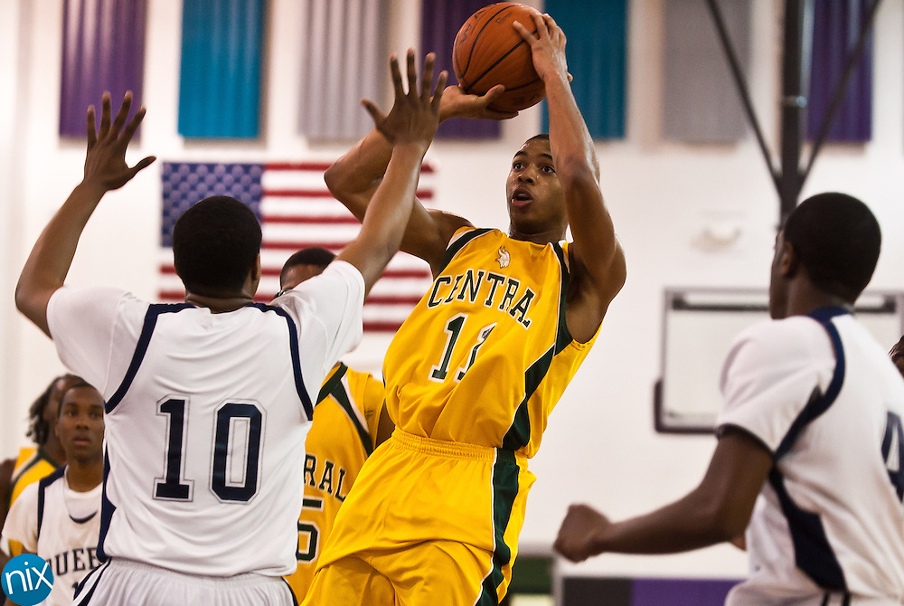 Central Cabarrus' LC Cooks looks to shoot against Queens Grant's BJ Gladden during the championship game of the CMC-Northeast Holiday Classic Basketball Tournament at Cox Mill High School Thursday night. Queens Grant won the game 81-65. (Photo by James Nix)