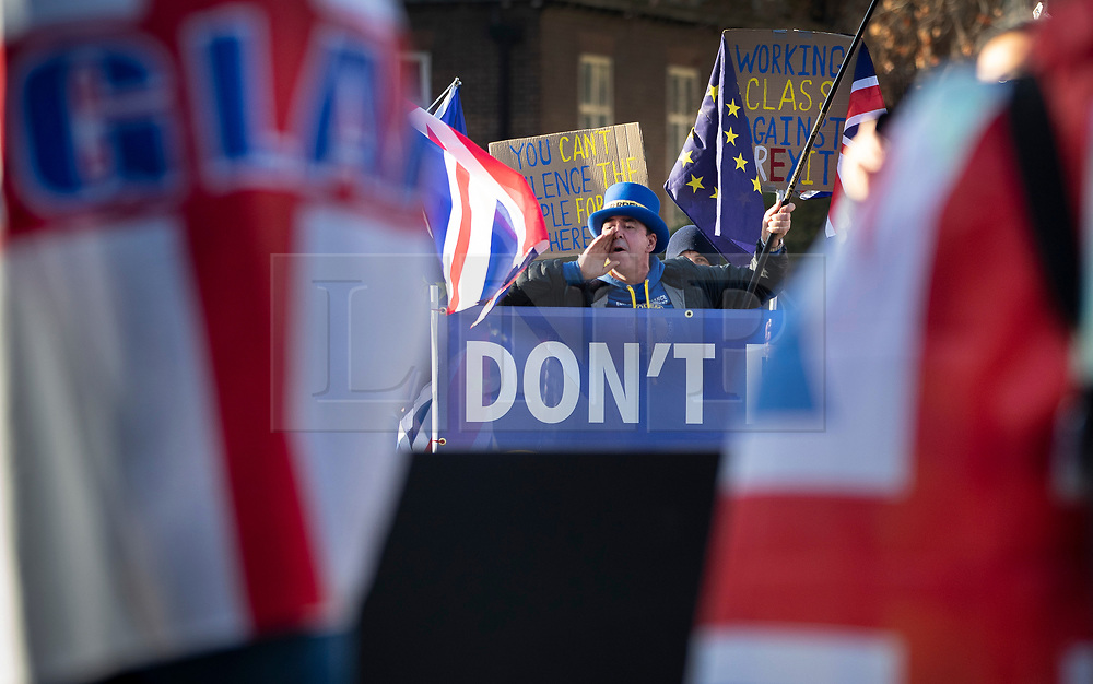 © Licensed to London News Pictures. 11/12/2018. London, UK. Anti-Brexit campaigner Steve Bray shouts slogans as he stands outside Parliament. Prime Minister Theresa May is touring European countries today in a bid to obtain changes to the Brexit withdrawal agreement.  Photo credit: Peter Macdiarmid/LNP