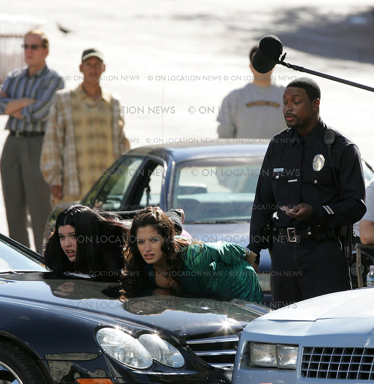 """Febuary 4, 2007  Los Angeles, CA.  In this funny scene for Rush Hour 3, several car accidents are caused by the poor traffic direction of Chris Tucker who is unaware that he was the cause of the accidents. Tucker is upset when 2 sexy women driving a Luxury Mercedes damages a 1981 Buick being driven by a """"brother"""".  Mia Tyler who is Liv Tyler's sister is the actress in purple and Sarah Shahi from """"The L Word""""  is the actress in the green dress. Non Exclusive Photo By Eric Ford / On Location News Tel: (818) 613-3955 EMail info@onlocationnews.com"""