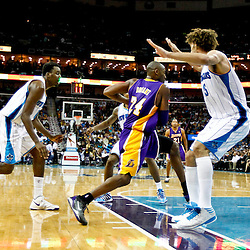 Dec 5, 2012; New Orleans, LA, USA; Los Angeles Lakers shooting guard Kobe Bryant (24) drives past New Orleans Hornets center Robin Lopez (15) on his way to a basket eclipsing 30,000 points in his care during the second quarter of a game against the New Orleans Hornets at the New Orleans Arena.  Mandatory Credit: Derick E. Hingle-USA TODAY Sports