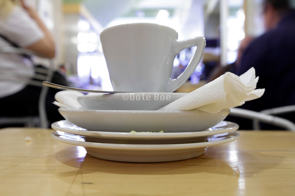 stacked cups and saucers inside a bar