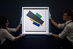 "© Licensed to London News Pictures. 19/06/2015. London, UK. Sotheby's staff show Kazimir Malevich's, ""Suprematism, 18th Construction"" (est. £20-£30m), at Sotheby's Impressionist, Modern & Contemporary Art preview, ahead of the sale on 24 June 2015. Leading the sale are Kazimir Malevich's, ""Suprematism, 18th Construction"" and Edouard Manet's ""Le Bar aux Folies-Bergère"".  Photo credit : Stephen Chung/LNP"