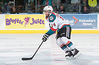 KELOWNA, CANADA - MAY 13: Rourke Chartier #14 of Kelowna Rockets skates with the puck against the Brandon Wheat Kings on May 13, 2015 during game 4 of the WHL final series at Prospera Place in Kelowna, British Columbia, Canada.  (Photo by Marissa Baecker/Shoot the Breeze)  *** Local Caption *** Rourke Chartier;