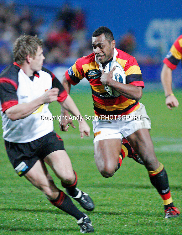 Waikato wing Sitiveni Sivivatu (R) beats Canterbury's Ben Blair to score the second of his tries during the Air New Zealand Cup week 3 rugby union match between Waikato and Canterbury at Waikato Stadium in Hamilton, New Zealand on Friday 11 August 2006. Photo: Andy Song/PHOTOSPORT