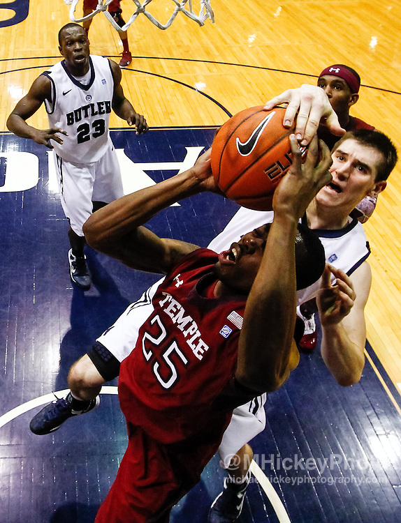 INDIANAPOLIS, IN - JANUARY 26: Andrew Smith #44 of the Butler Bulldogs blocks the shot of Quenton DeCosey #25 of the Temple Owls from behind  at Hinkle Fieldhouse on January 26, 2013 in Indianapolis, Indiana. Butler defeated Temple 83-71. (Photo by Michael Hickey/Getty Images) *** Local Caption *** Andrew Smith; Quenton DeCosey