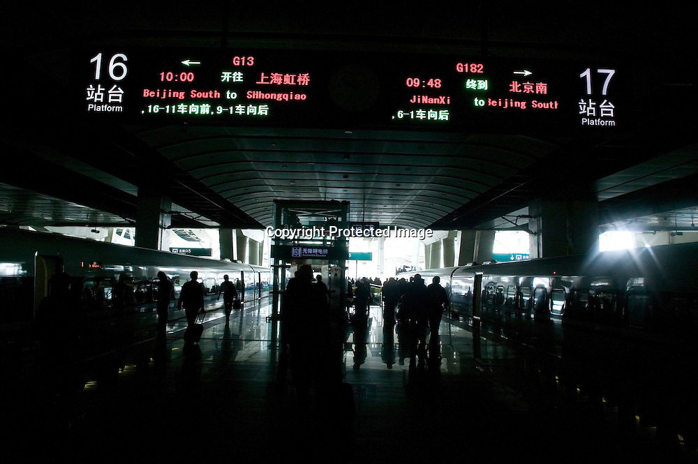 Beijing, September 11 , 2011 : Passengers arrive on the platform . The passenger-dedicated trunk line opened in June 2011, reducing the 1,318 km journey between Beijing and Shanghai to less than 5 hours. Trains reach top speeds of 300 km/h (186 mph) for the entire trip.