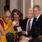 The Dalai Lama receives the Congressional Gold Medal in the Rotunda of the US Capitol Wednesday, Oct. 17, 2007.  Also attending are Pres. Bush and Speaker of the US House of Representatives Nancy Pelosi...Photo by Khue Bui