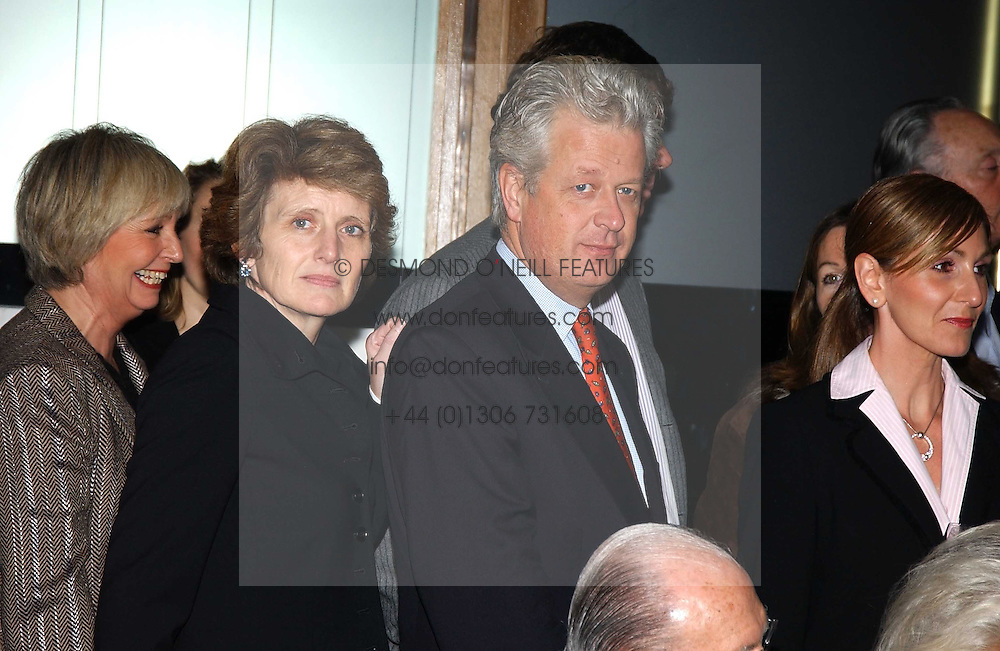 LORD & LADY KENILWORTH at a fashion show of the new fashion label Chester Bonham held at the Aston Martin Showroom, Park Lane, London on 15th November 2004.<br />