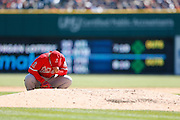 DETROIT, MI - APRIL 19: C.J. Wilson #33 of the Los Angeles Angels kneels to pray before taking the mound against the Detroit Tigers during the game at Comerica Park on April 19, 2014 in Detroit, Michigan. The Tigers won 5-2. (Photo by Joe Robbins)