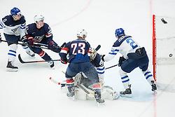Matt Hendricks of USA scores second goal for USA vs Pekka Rinne of Finland and Jyrki Jokipakka of Finland during Ice Hockey match between USA and Finland at Day 1 in Group B of 2015 IIHF World Championship, on May 1, 2015 in CEZ Arena, Ostrava, Czech Republic. Photo by Vid Ponikvar / Sportida