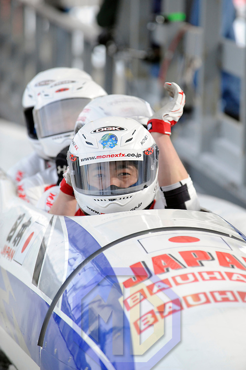 01 March 2009:   The Japan 1 bobsled driven by Hiroshi Suzuki with sidepushers Shinji Doigawa and Ryuichi Kobayashi, and brakeman Mizuki Tsujio glance at the clock after their 4th run at the 4-Man World Championships competition on March 1 at the Olympic Sports Complex in Lake Placid, NY.  The USA 1 bobsled driven by Steven Holcomb with sidepushers Justin Olsen and Steve Mesler, and brakeman Curtis Tomasevicz won the competition and the World Championship bringing the U.S. their first world championship since 1959 with a time of 3:36.61.