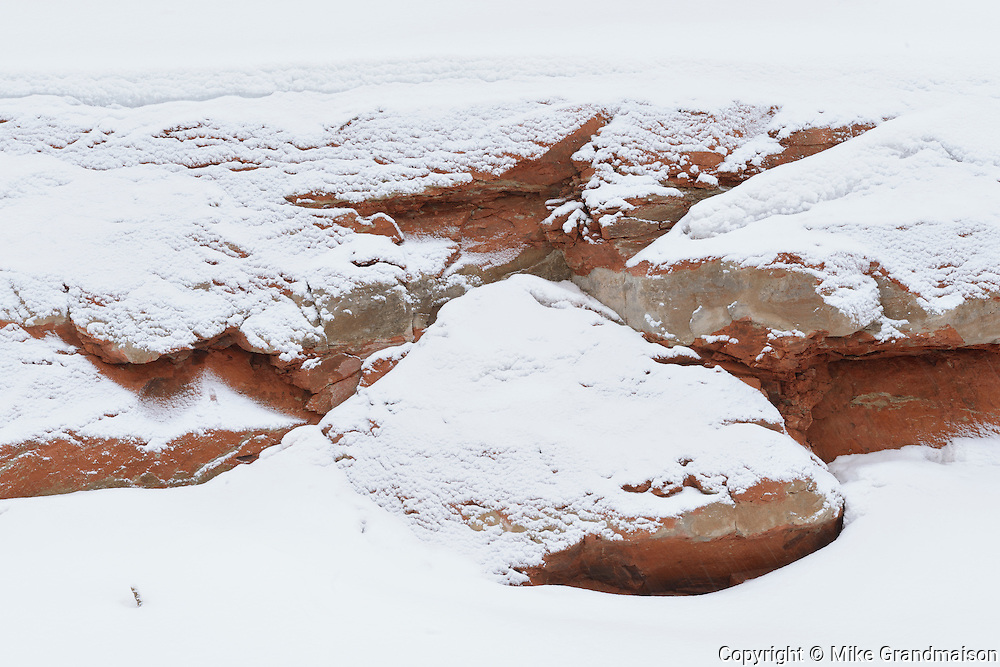 Red rock covered in snow<br /> Nipigon<br /> Ontario<br /> Canada