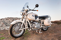 A 1960s BMW R60US motorcycle (PR) on the side of a coastal road in Sonoma County California.