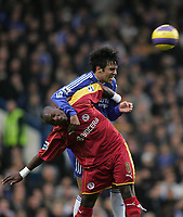 Photo: Lee Earle.<br /> Chelsea v Reading. The Barclays Premiership. 26/12/2006. Chelsea's Paulo Ferreira (R) outjumps Leroy Lita.
