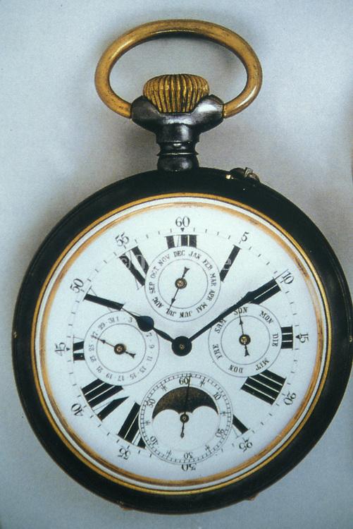 close up of elaborate pocket watch