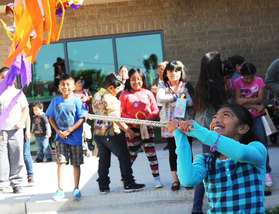 More than fifty enthusiastic children took part on Thursday afternoon in an Easter-themed piñata party at the Cesar Chavez Library. Many of these kids had spent several hours doing their vacation homework, so to the cheers of parents, they eagerly took shots at emptying the colorful candy-filled star of its contents. After all the kids had a turn, and were munching from Easter baskets, the hard-working staff at the library had their turn at bat.