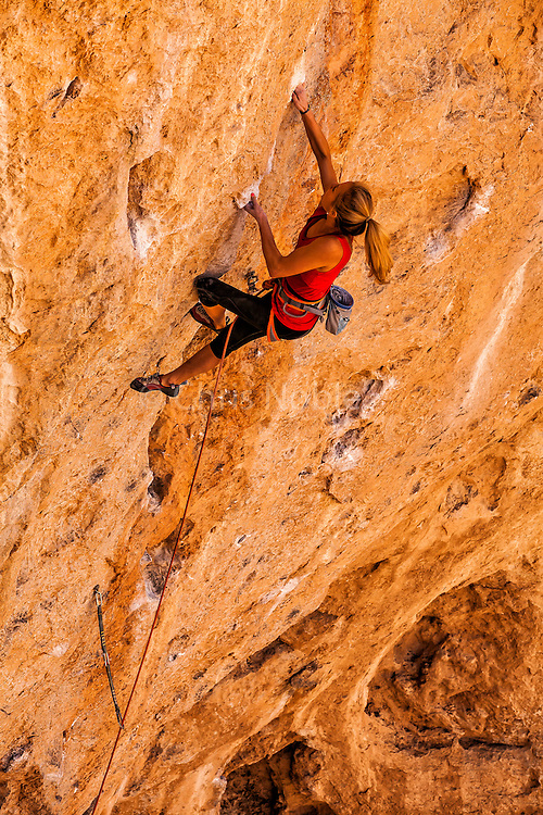 """Sasha DiGiulian climbing a route named """"Golden"""" rated14b at """"The Cathedral,"""" near St. George Utah."""