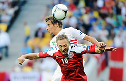 13-06-2012 VOETBAL: UEFA EURO 2012 DAY 6: POLEN OEKRAINE<br /> FABIO COENTRAO DENNIS ROMMEDAHL during the UEFA EURO 2012 group B match between Denemarken en Portugal at Arena Lwiw, Lemberg, UKR<br /> ***NETHERLANDS ONLY***<br /> ©2012-FotoHoogendoorn.nl