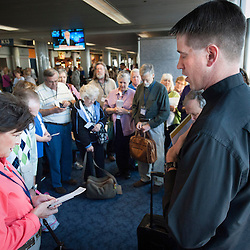 Lisa Johnston | lisajohnston@archstl.org Father Christopher Martin, Director of Vocations for the Archdiocese of St. Louis, led the pilgrims from the archdiocese in prayer at the airport as they were about to board their flight for Rome. The pilgrims will be present for the Mass of canonization of Pope John Paul II and Pope John XXIII on April 27, 2014, Divine Mercy Sunday.  Father Christopher Martin, Director of Vocations for the Archdiocese, is leading the pilgrimage.