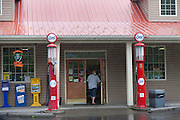 Gas station with antique pumps in the rain just over the Virginia border on Route 460 May 2011