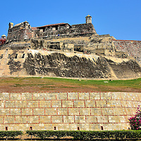 Outer Wall of Castillo San Felipe de Barajas in Cartagena, Colombia<br /> Cartagena's landmark fort was first built on the Hill of San Lázaro during the early 16th century. When the citadel was significantly expanded in 1657, it was named in honor of Felipe IV. He was the King of Spain from 1621 until 1665. The Castillo has the distinction of being the largest military fortification ever built within the Spanish colonies. It is easy to see how these massive walls repelled an attack by over 23,500 British soldiers in 1741. The Castillo San Felipe de Barajas was declared a UNESCO World Heritage Site in 1984.