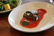 goat milk cheese wrapped in aubergine