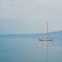 A pleasure boat moored on calm blue waters in Greece