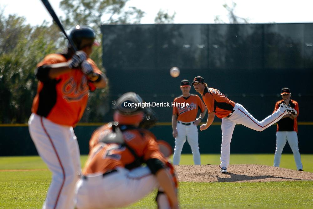 February 21, 2011; Sarasota, FL, USA; Baltimore Orioles starting pitcher Brian Matusz (17) throws during spring training at Ed Smith Stadium.  Mandatory Credit: Derick E. Hingle-US PRESSWIRE