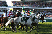 Bringing the line round as they get ready for the start of the 5:15pm The Randox Health Grand National Steeple Chase (Grade 3) 4m 2f during the Grand National Meeting at Aintree, Liverpool, United Kingdom on 6 April 2019.