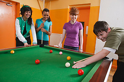 Teenagers playing pool in Youth Club. Cleared for Mental Health Issues.