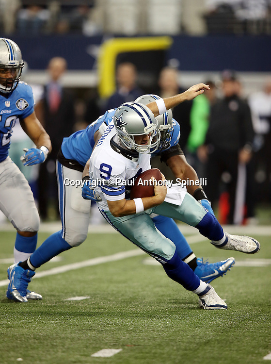 Detroit Lions defensive end Ezekiel Ansah (94) chases Dallas Cowboys quarterback Tony Romo (9) on a first quarter play during the NFL week 18 NFC Wild Card postseason football game against the Dallas Cowboys on Sunday, Jan. 4, 2015 in Arlington, Texas. The Cowboys won the game 24-20. ©Paul Anthony Spinelli