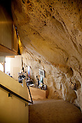 Festus, Missouri: The staircase from the bedrooms to the first floor living area adjoins the cave wall of Curt and Deborah Sleeper's 2,000 square foot home. It is built inside a 17,000 square foot cave in this small town south of St. Louis.