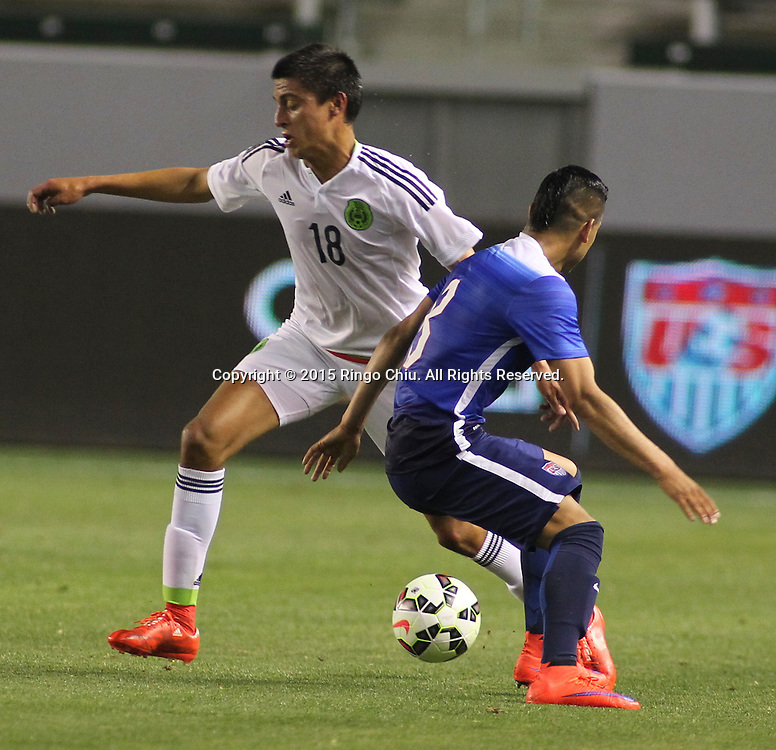 United States' Benji Joya #8 actions against Mexico's Rosario Enrique Cota Carrazco #18 during a men's national team international friendly match, April 22, 2015, at StubHub Center in Carson, California. United States won 3-0. (Photo by Ringo Chiu/PHOTOFORMULA.com)