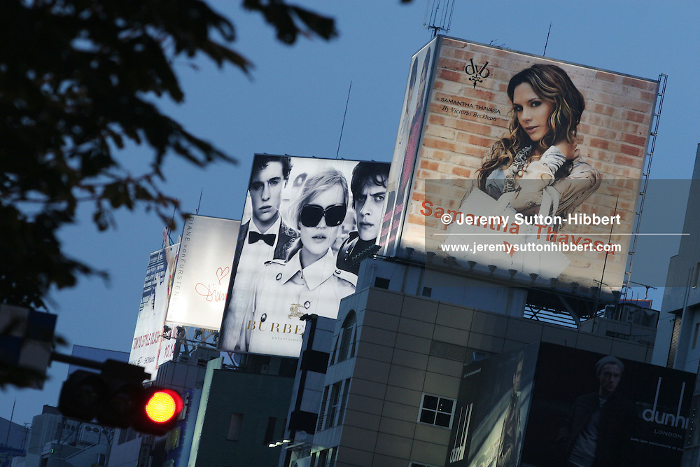 VICTORIA BECKHAM AND KATE MOSS ADVERTISING, TOKYO, JAPAN. Billboards high above a street in Omotesando district depicting British celebrity (and wife of footballer David Beckham) Victoria Beckham advertising 'Samantha Thavasa' fashion products, and also British supermodel advertising 'Burberry' fashion products, in Tokyo, Japan, on Wednesday, Oct. 11th 2006.