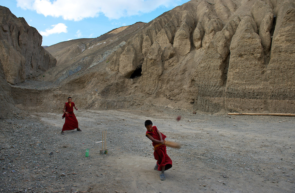 Young novice monks play cricket outside Lamayuru Gompa.