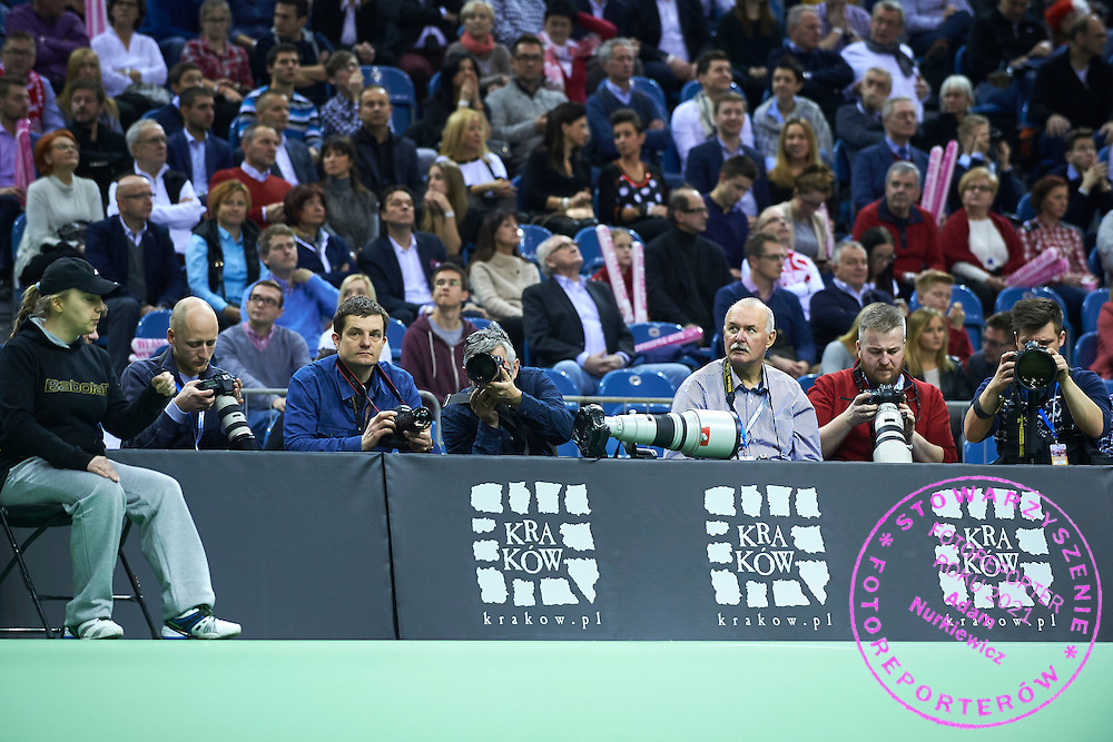 (L-R) Photographer (4L) Andrzej Iwanczuk (Reporter Agency) and (3R) Jacek Bednarczyk (Polish Press Agency - PAP) and (1R) Maciej Gilert (Epoka Agency) during First Day of the Fed Cup / World Group 1st round tennis match between Poland and Russia at Tauron Krakow Arena on February 7, 2015 in Cracow, Poland.<br /> <br /> Poland, Cracow, February 7, 2015<br /> <br /> Picture also available in RAW (NEF) or TIFF format on special request.<br /> <br /> For editorial use only. Any commercial or promotional use requires permission.<br /> <br /> Adam Nurkiewicz declares that he has no rights to the image of people at the photographs of his authorship.<br /> <br /> Mandatory credit:<br /> Photo by &copy; Adam Nurkiewicz / Mediasport