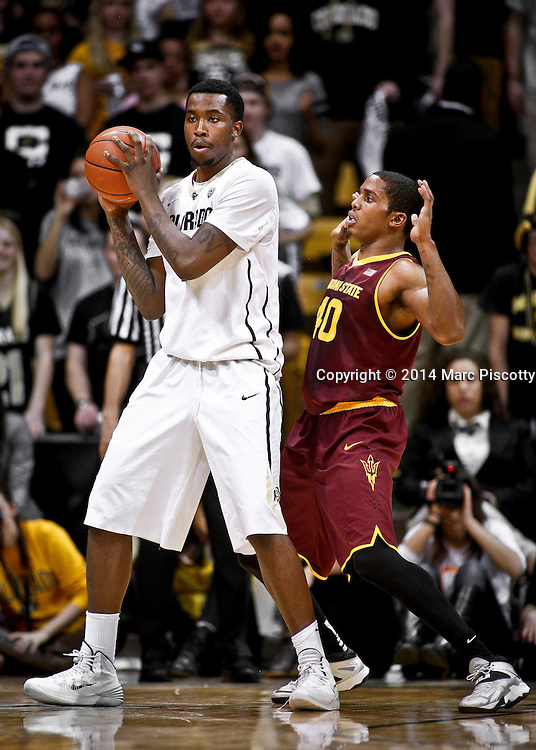 SHOT 2/19/14 10:50:41 PM - Colorado's Wesley Gordon #1 tries to back down Arizona State's Shaquielle McKissic #40 during their regular season Pac-12 basketball game at the Coors Events Center in Boulder, Co. Colorado won the game 61-52.<br /> (Photo by Marc Piscotty / &copy; 2014)