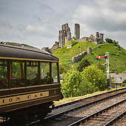 Corfe Castle from the Swanage Railway. A short walk from this 11th century castle ruins on the Isle of Purbeck in Dorset, is the 19th century railway built to take tourists to the seaside, now re-built with steam engines and heritage tours. The castle alone is well worth a visit with it's key role in the English Civil War and the working historic railway and views are a real bonus.