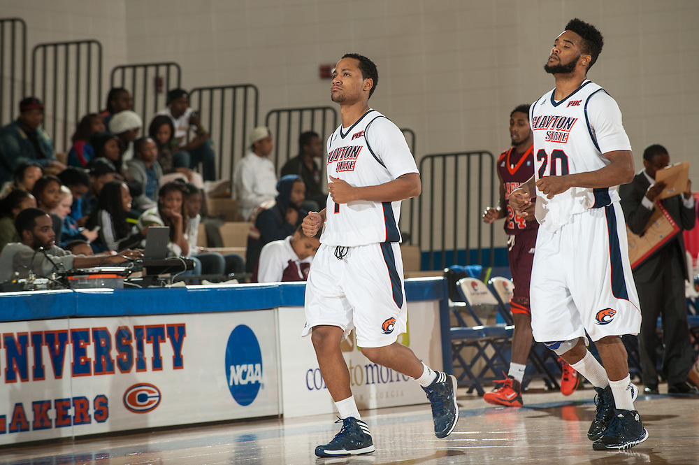 Nov. 23, 2013; Morrow, GA, USA; Clayton State player guard Corbyn Moye and guard Craig Wong during game against Claflin at Clayton State. Photo by Kevin Liles / kevindliles.com