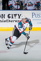KELOWNA, CANADA - FEBRUARY 9: Madison Bowey #4 of Kelowna Rockets skates with the puck against the Prince George Cougars on February 9, 2015 at Prospera Place in Kelowna, British Columbia, Canada.  (Photo by Marissa Baecker/Shoot the Breeze)  *** Local Caption *** Madison Bowey;