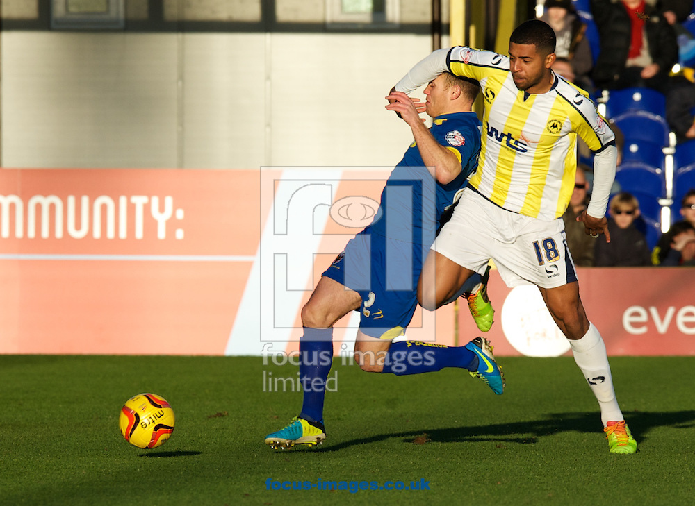 Picture by Alan Stanford/Focus Images Ltd +44 7915 056117<br /> 11/01/2014<br /> Barry Fuller of AFC Wimbledon and Joss Labadie of Torquay United fight for the ball during the Sky Bet League 2 match at the Cherry Red Records Stadium, Kingston.