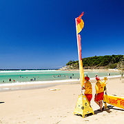 Lifesavers on duty at Cylinder Beach on North Stradbroke Island, Queensland, Australia. The flags mark the edges of the area recommended for swimming, as swimmers are encourage to stay between the flags. North Stradbroke Island, just off Queensland's capital city of Brisbane, is the world's second largest sand island and, with its miles of sandy beaches, a popular summer holiday destination.