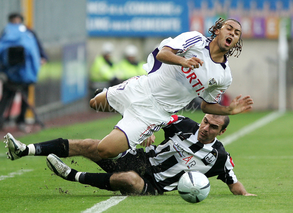 Anderlecht's Vanden Borre is tackled by Neftchi Baku's Abbasov in Champions League qualifier match in Brussels.  Anderlecht's Anthony Vanden Borre (L) is tackled by Neftchi Baku's Ruslan Abbasov during their UEFA Champions League second qualifying round, first leg soccer match at the Constant Vanden Stock stadium in Brussels July 26, 2005. REUTERS/Thierry Roge