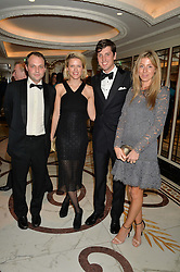 Left to right, the HON.EDWARD SACKVILLE, ZOE WARREN, JAKE WARREN and SOPHIA SACKVILLE at the 24th Cartier Racing Awards held at The Dorchester, Park Lane, London on 11th November 2014.