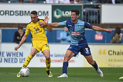 Oxford United midfielder Gavin Whyte (16) battles for possession  with Wycombe Wanderers defender Joe Jacobson (3) during the EFL Sky Bet League 1 match between Wycombe Wanderers and Oxford United at Adams Park, High Wycombe, England on 15 September 2018.