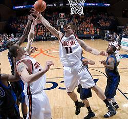 Virginia Cavaliers forward Laurynas Mikalauskas (11) grabs a rebound against Longwood.  The Virginia Cavaliers Men's Basketball Team defeated Longwood University 90-49 at the John Paul Jones Arena in Charlottesville, VA on February 13, 2007.