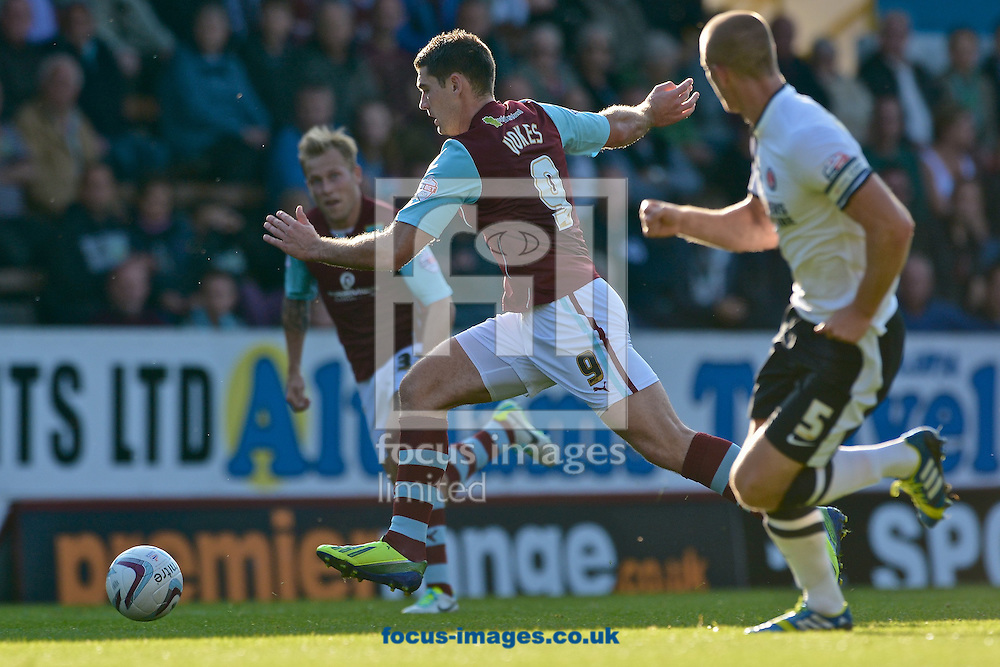 Picture by Ian Wadkins/Focus Images Ltd +44 7877 568959<br /> 28/09/2013<br /> Sam Vokes of Burnley takes on Michael Morrison of Charlton Athletic during the Sky Bet Championship match at Turf Moor, Burnley.